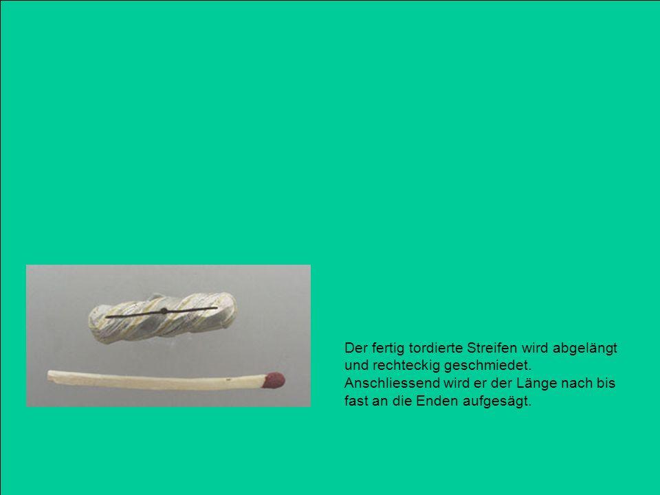 Der fertig tordierte Streifen wird abgelängt und rechteckig geschmiedet.