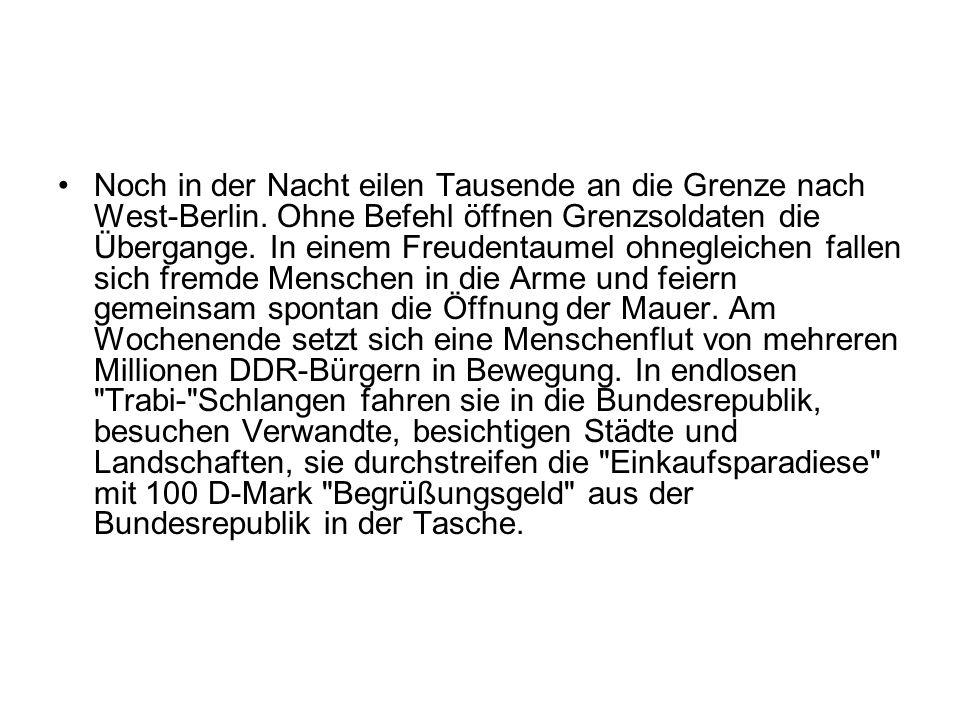 Noch in der Nacht eilen Tausende an die Grenze nach West-Berlin