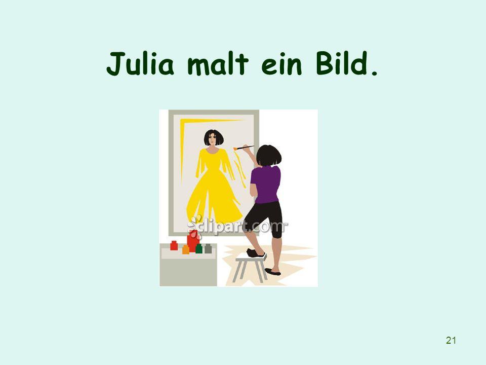 Julia malt ein Bild.