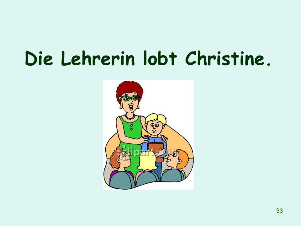 Die Lehrerin lobt Christine.