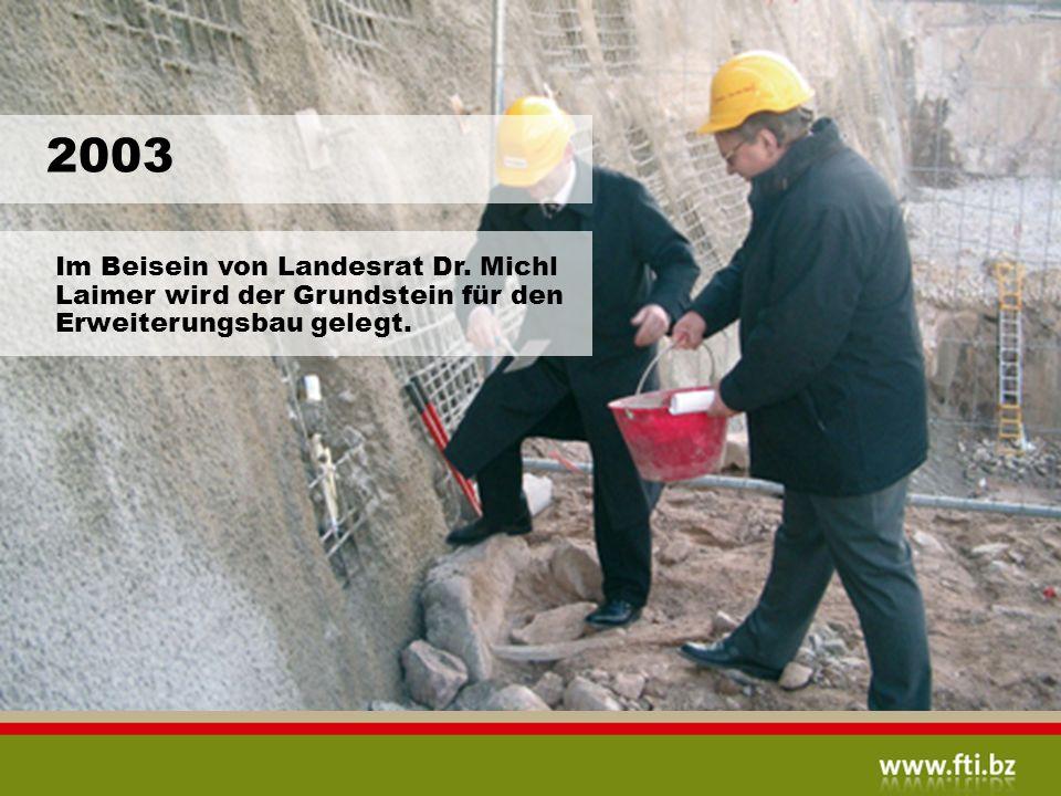 2003 Im Beisein von Landesrat Dr. Michl Laimer wird der Grundstein für den Erweiterungsbau gelegt.