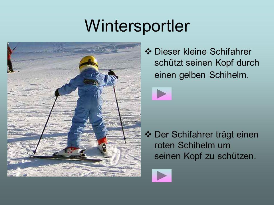 Wintersportler Dieser kleine Schifahrer schützt seinen Kopf durch einen gelben Schihelm.