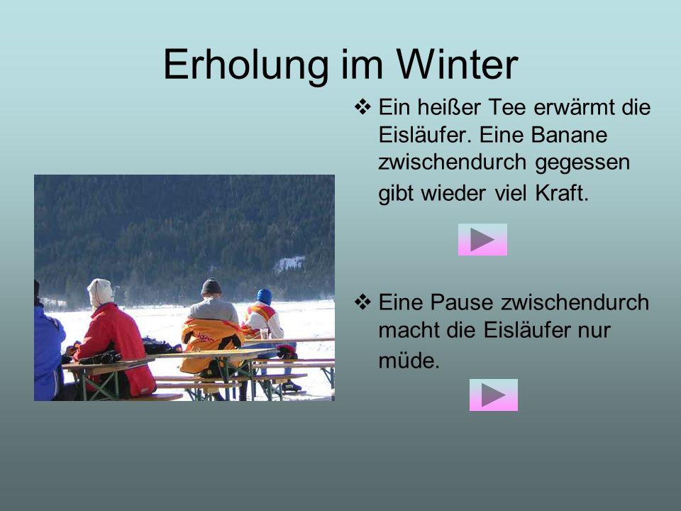 Erholung im Winter Ein heißer Tee erwärmt die Eisläufer. Eine Banane zwischendurch gegessen gibt wieder viel Kraft.