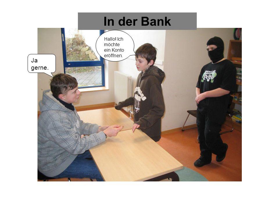 In der Bank Hallo! Ich möchte ein Konto eröffnen. Ja gerne.