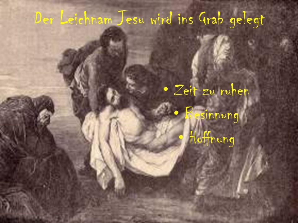 Der Leichnam Jesu wird ins Grab gelegt