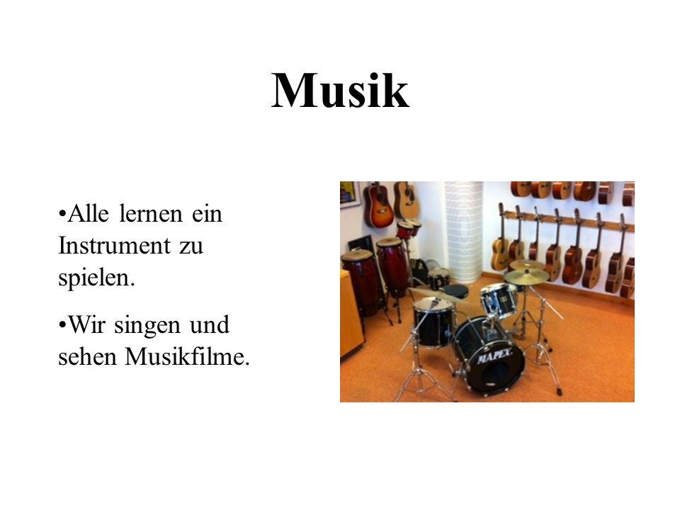 Musik Alle lernen ein Instrument zu spielen.