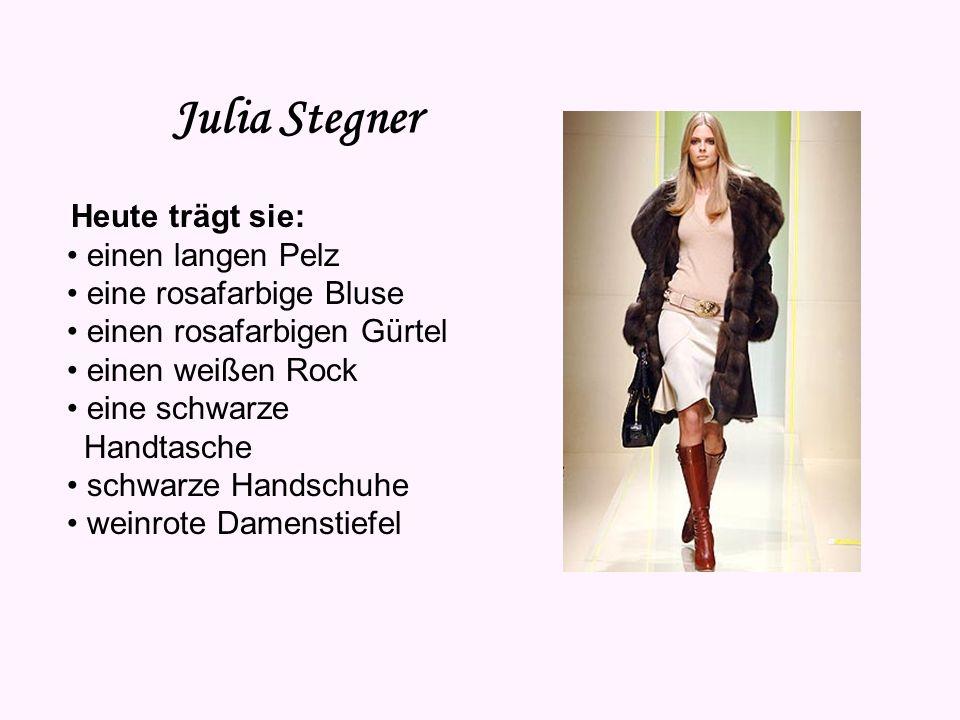 Julia Stegner • einen langen Pelz • eine rosafarbige Bluse