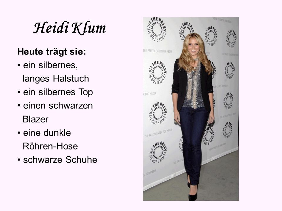Heidi Klum Heute trägt sie: • ein silbernes, langes Halstuch