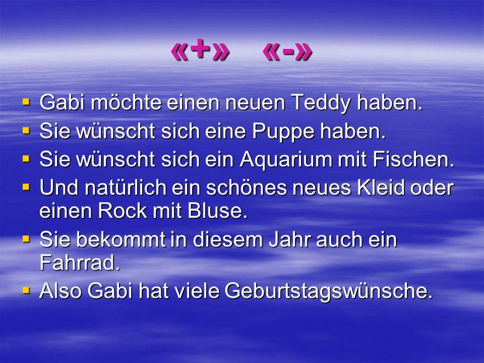 «+» «-» Gabi möchte einen neuen Teddy haben.