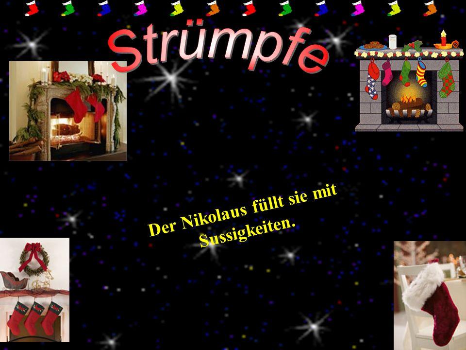 Der Nikolaus füllt sie mit Sussigkeiten.
