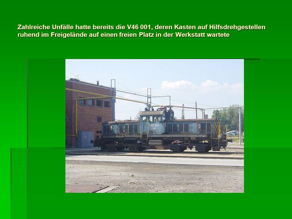 Zahlreiche Unfälle hatte bereits die V46 001, deren Kasten auf Hilfsdrehgestellen ruhend im Freigelände auf einen freien Platz in der Werkstatt wartete