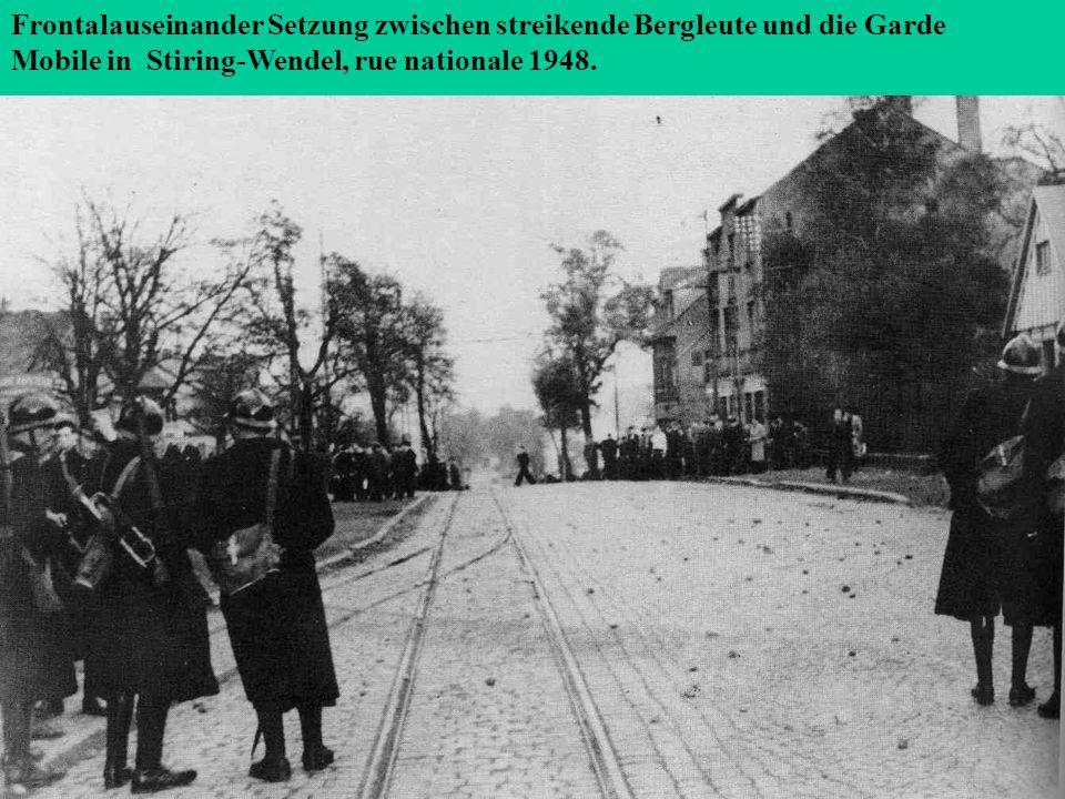 Frontalauseinander Setzung zwischen streikende Bergleute und die Garde Mobile in Stiring-Wendel, rue nationale 1948.