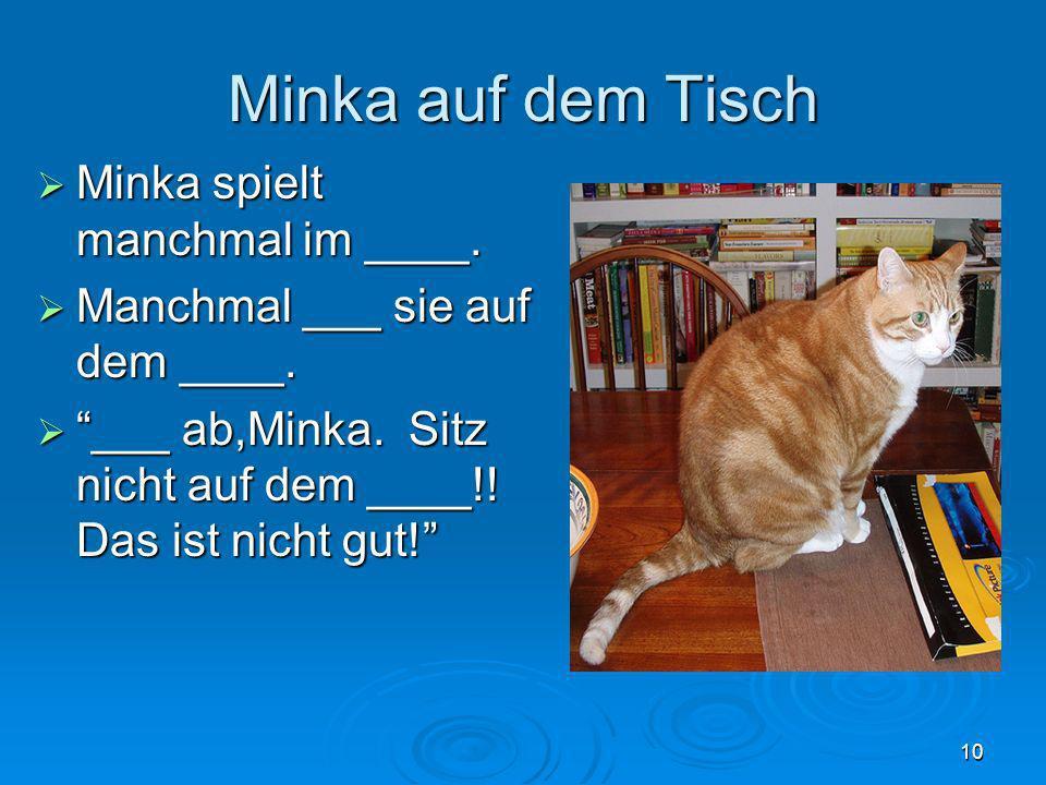 Minka auf dem Tisch Minka spielt manchmal im ____.