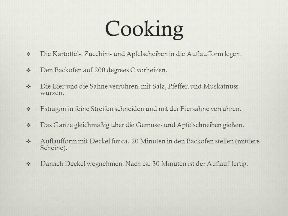 Cooking Die Kartoffel-, Zucchini- und Apfelscheiben in die Auflaufform legen. Den Backofen auf 200 degrees C vorheizen.