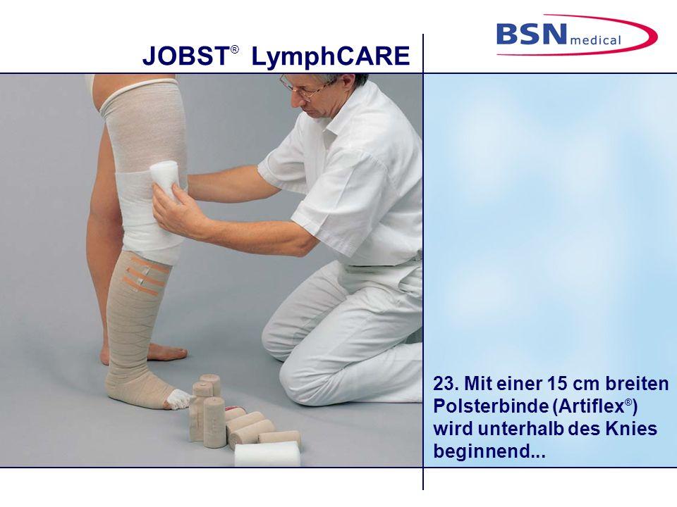 23. Mit einer 15 cm breiten Polsterbinde (Artiflex®) wird unterhalb des Knies beginnend...