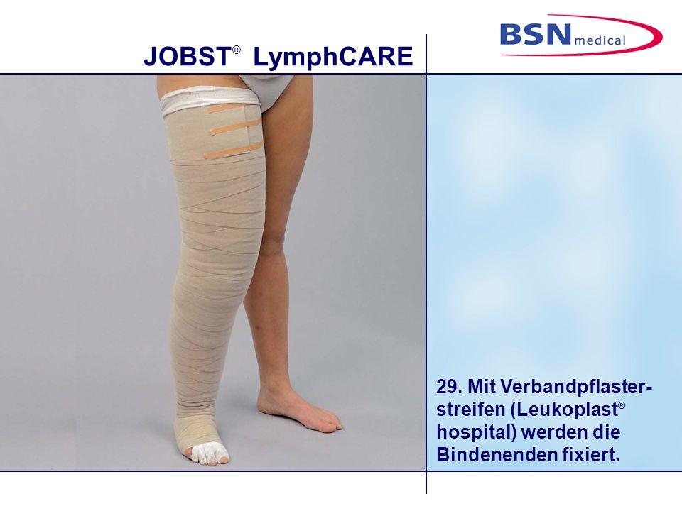 29. Mit Verbandpflaster-streifen (Leukoplast® hospital) werden die Bindenenden fixiert.