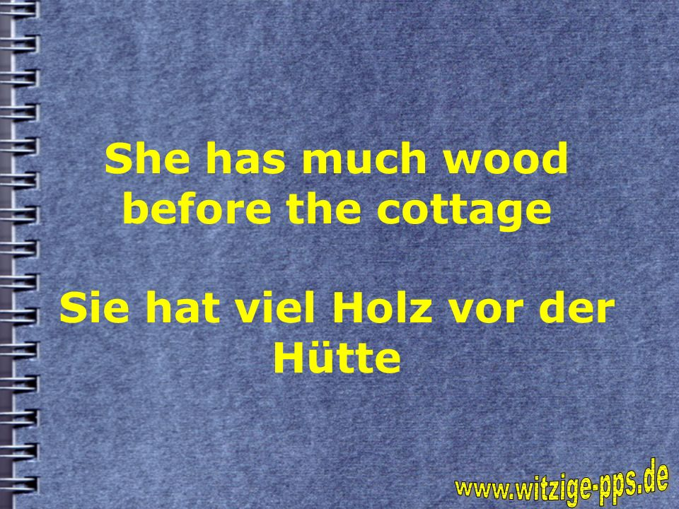 She has much wood before the cottage Sie hat viel Holz vor der Hütte