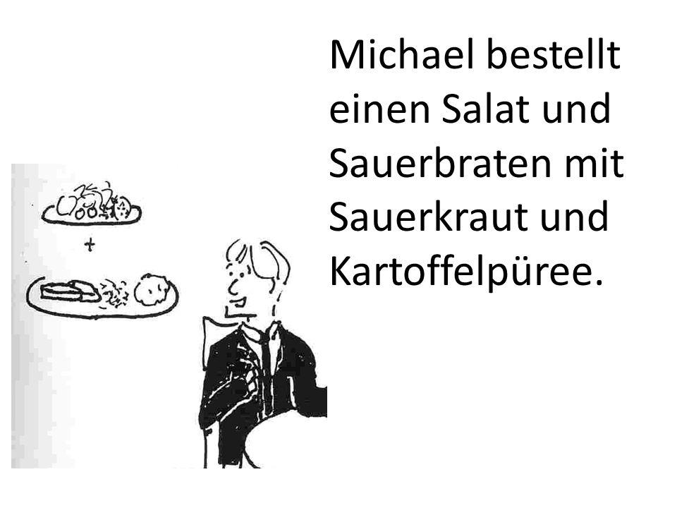 Michael bestellt einen Salat und Sauerbraten mit Sauerkraut und Kartoffelpüree.