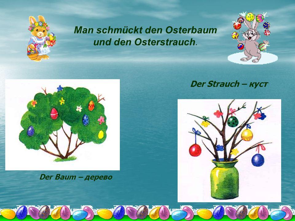 Man schmückt den Osterbaum und den Osterstrauch.