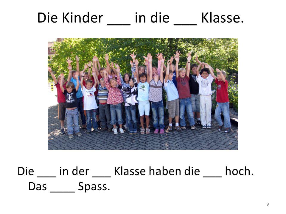 Die Kinder ___ in die ___ Klasse.
