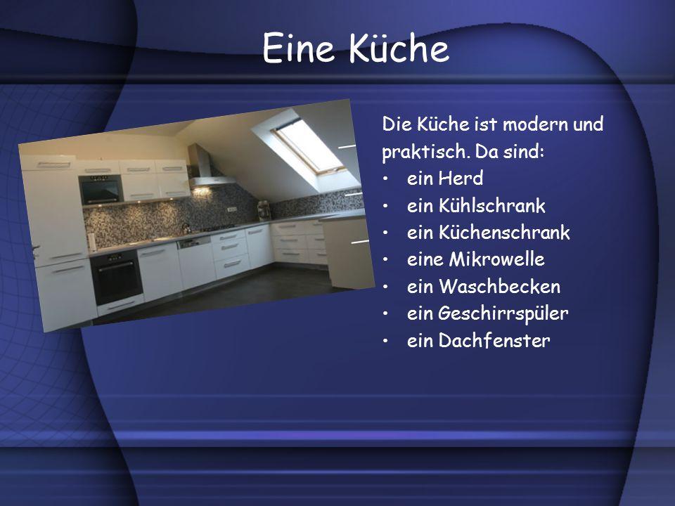 Eine Küche Die Küche ist modern und praktisch. Da sind: ein Herd