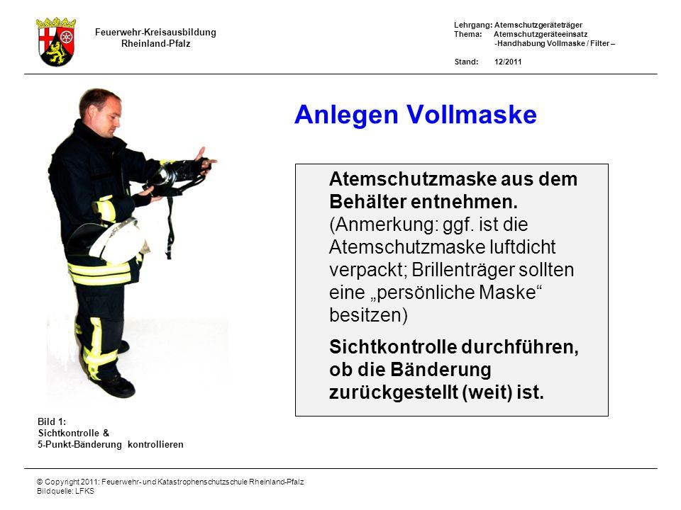Anlegen Vollmaske Atemschutzmaske aus dem Behälter entnehmen.