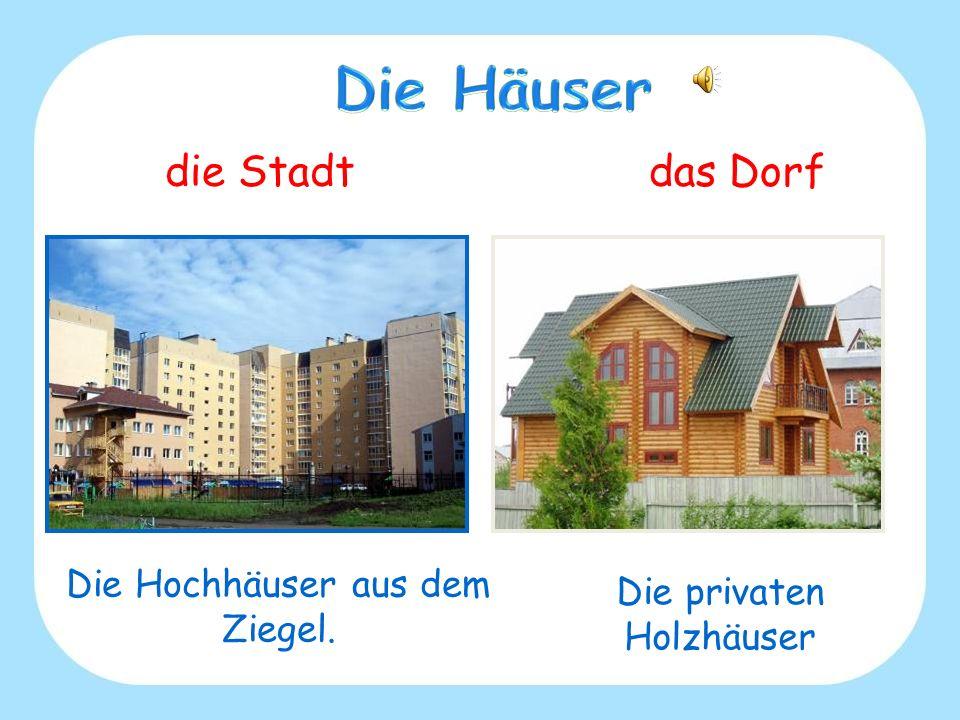 Die Häuser die Stadt das Dorf Die Hochhäuser aus dem Ziegel.