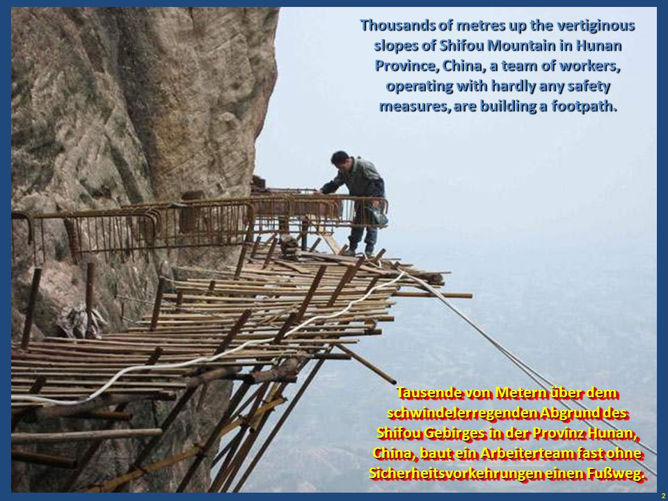 Thousands of metres up the vertiginous slopes of Shifou Mountain in Hunan Province, China, a team of workers, operating with hardly any safety measures, are building a footpath.