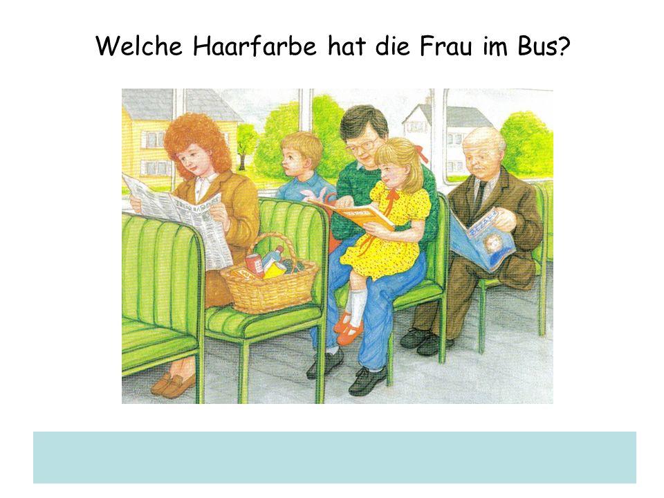 Welche Haarfarbe hat die Frau im Bus